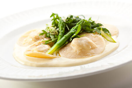 Italian Cuisine - Ravioli with Rocket Salad and Asparagus photo