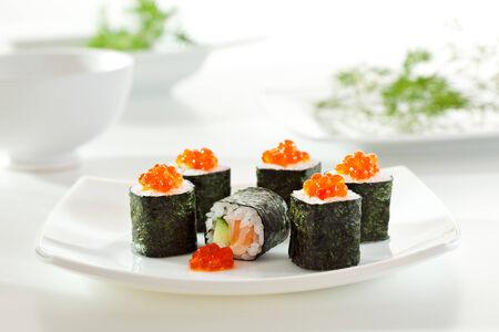 sake maki: Sake Maki Sushi - Roll with Fresh Salmon and Cucumber inside.
