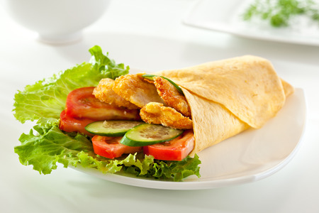 Chicken Burrito with Vegetables and Salad Leaf photo
