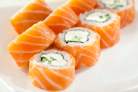 maki sushi: Philadelphia Maki Sushi made of Cream Cheese and Cucumber inside. Salmon outside Stock Photo