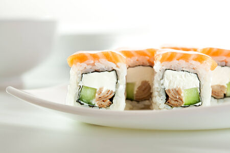 Maki Sushi made of Omelet, Cream Cheese and Cucumber inside. Salmon  outside photo