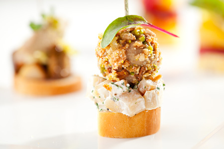 canapes: Delicious Mushrooms Canapes over White