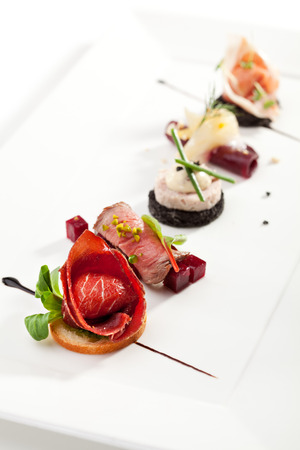 Meat Canapes on White Dish 写真素材