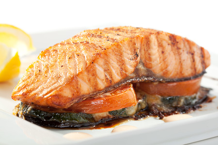 Salmon Steak with Baked Vegetables, White Sauce and Lemon