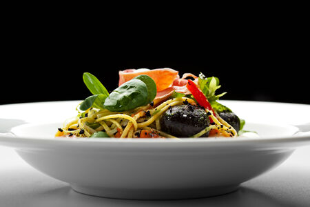 Spaghetti with Vegetables, Ham, Black Olives, Rucola and Pesto Sauce photo
