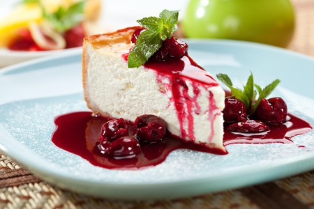 dessert plate: Dessert - Cheesecake with Berries Sauce and Green Mint
