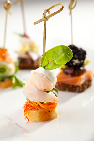 canapes: Seafood and Vegetables Canapes Dish Stock Photo