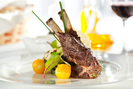 dinner dish: Grilled Rack of Lamb with Mushrooms Sauce and Vegetables Stock Photo