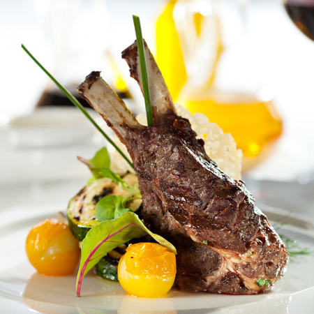 veal: Grilled Rack of Lamb with Mushrooms Sauce and Vegetables Stock Photo