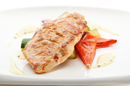red breast: BBQ Chicken Breast on Grilled Vegetables Stock Photo