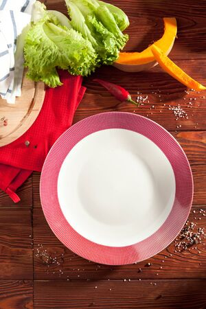 empty plate: Empty Plate on Wooden Table Stock Photo