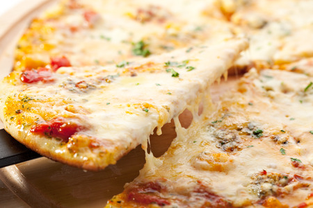 sliced cheese: Pizza with Various Type of Cheese Stock Photo