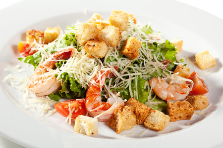 caesar salad: Caesar Salad with Seafood. Comprises Romaine Salad Leaf and Croutons Dressed with Parmesan Cheese Stock Photo