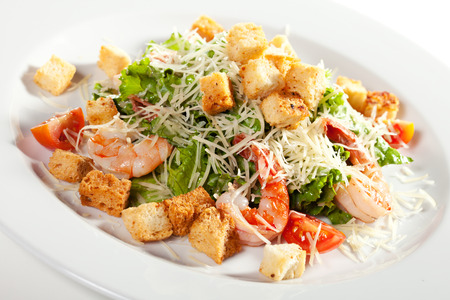 romaine: Caesar Salad with Seafood. Comprises Romaine Salad Leaf and Croutons Dressed with Parmesan Cheese Stock Photo