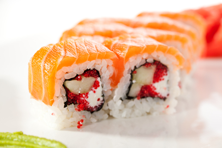 Maki Sushi - Sushi Roll with Cucumber, Tobiko and Cream Cheese inside. Salmon outside