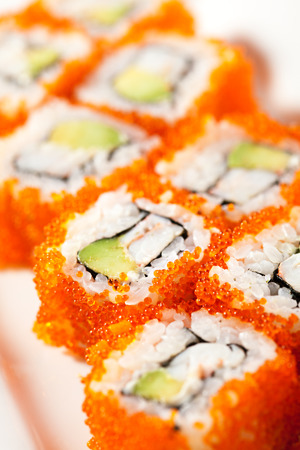 smelt: California Maki Sushi with Masago  - Roll made of Crab Meat, Avocado, Cucumber inside. Smelt roe outside