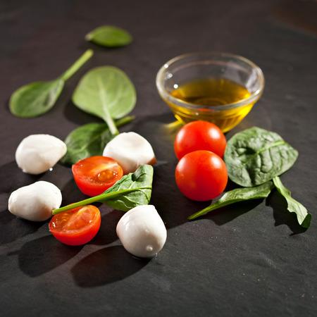 mozzarella cheese: Mozzarella Cheese with Tomato and Green Leaves