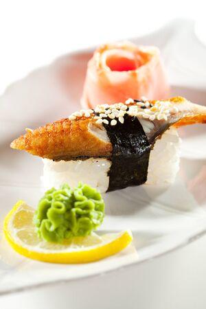 grig: Japanese Cuisine -  Smoked Eel Nigiri Sushi with Ginger and Wasabi Stock Photo