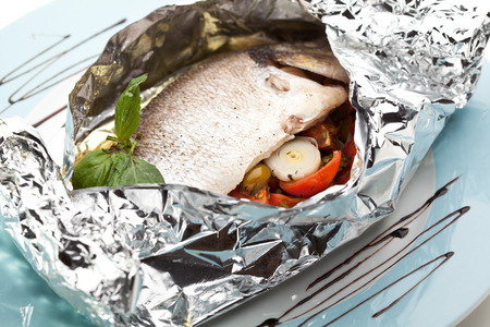 sea bass: Fish in Foil with Cherry Tomato, Onions and Vegetables