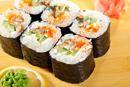 grig: Japanese Cuisine - Sushi Roll with Eel, Cucumber and Masago inside. Nori outside