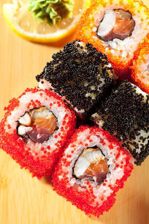 grig: Japanese Cuisine - Sushi Roll with Tuna, Salmon, Eel and Shrimp inside. Tobiko outside