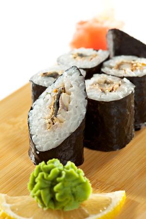 grig: Unagi Maki - Smoked Eel Sushi Roll on the Wooden Plate