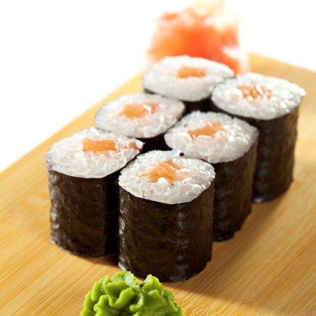 maki: Sake Maki Sushi - Roll with Fresh Salmon on the Wood Plate