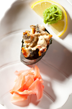 grig: Spicy Eel Gunkan Sushi. Garnished with Ginger and Wasabi Stock Photo