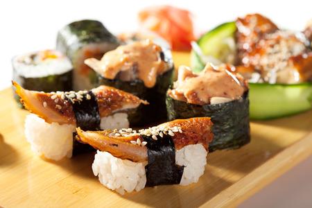 sushi: Japanese Cuisine - Eel Sushi Set. Nigiri and Gunkan Sushi with Maki Sushi and Sashimi