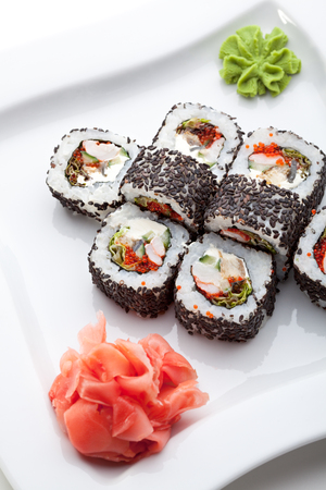 grig: Japanese Cuisine - Sushi Roll with Shrimps, Eel, Salad Leaf, Cream Cheese and Tobiko inside. Sesame outside