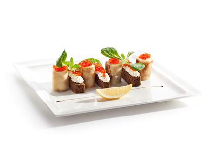 Pancake Roll with Cream and Salmon Caviar. Garnished with Lemon Slice photo