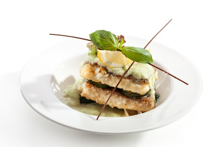 Fish FIllet with Zucchini and Sauce Stock Photo