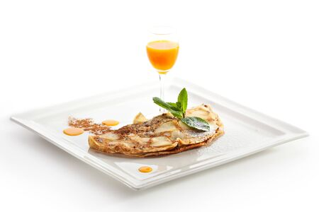 buckthorn: Pancake with Apple and Nuts. Garnished with Buckthorn Sauce Stock Photo