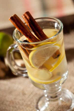 hot drink: Mulled White Wine Cocktail with Cinnamon Sticks Stock Photo