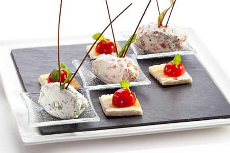 cream cheese: Cream Cheese with Salmon, Tomato and Herbs. Garnished with Toast Stock Photo