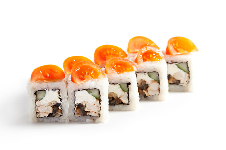 grig: Japanese Cuisine - Sushi Roll with Cucumber, Chicken, Cream Cheese and Smoked Eel inside. Topped with Cherry Tomato Stock Photo
