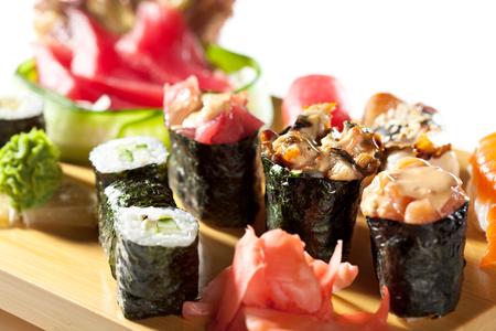 japanese cuisine: Japanese Cuisine - Sushi Set: Salmon, Conger and Tuna Sushi with Salad Leaf. Nigiri, Maki Sushi and Sashimi