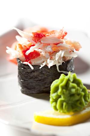crab meat: Spicy Crab Meat Gunkan Sushi. Garnished with Ginger and Wasabi