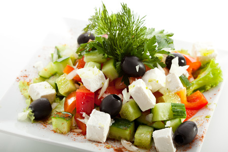 Greek Salad - Feta Cheese, Tomatoes, Salad Leaves,  Olive and Vegetables Stock Photo