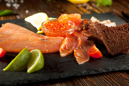 cured: Cured FIsh with Lime, Bread and Salmon Roe Stock Photo