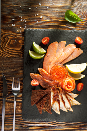 assorted: Cured FIsh with Lime, Bread and Salmon Roe Stock Photo