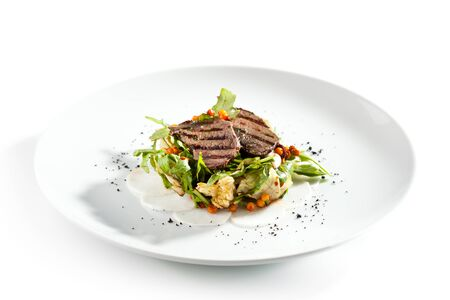 Warm Salad with Grilled Meat and Rocket Salad Stock Photo