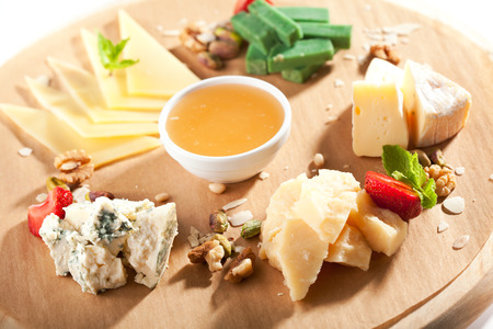 cheese platter: Cheese Platter with Honey Dip and Strawberries