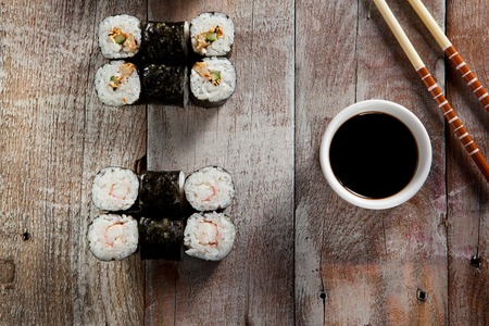 wooden board: Sushi Set on Wooden Background