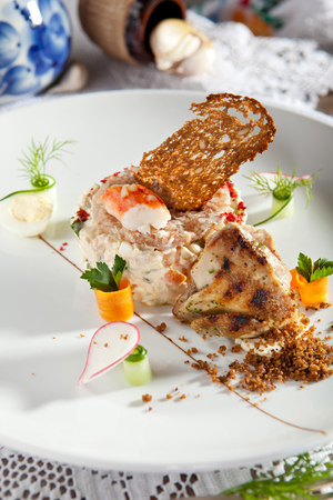 crab meat: Salad with King Red Crab and Vegetables. Garnished with Grilled Wachtel Stock Photo