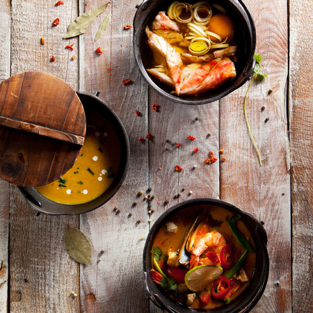 seafood soup: Seafood Soups on Wooden Background