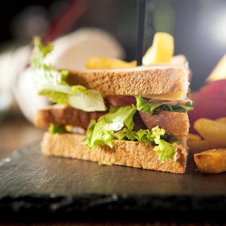 sandwiches: American Foods - Classic Club Sandwich with French Fries