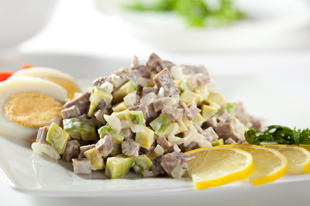 russian salad: Olivier Russian Salad Dressed with Lemon Slice and Egg