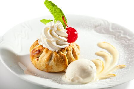 cream pie: Dessert - Pie with Whipped Cream and Ice Cream Stock Photo