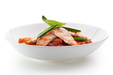 fish sauce: Pasta Penne with Fried Salmon. Garnished with Tomato Sauce Stock Photo